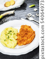 Chicken steak or schnitzel with mashed potatoes 54064973