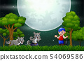 The old man with a wolfs in the forest at night 54069586