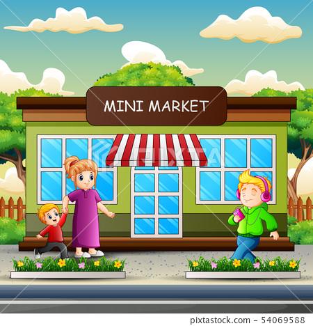 Happy people walking in front the mini market 54069588