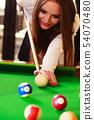 Young woman having fun with billiard. 54070480
