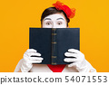 portrait of mime woman artist with book 54071553