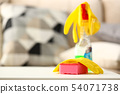Yellow house glove lying on pink sponge as symbol of chore routine work 54071738