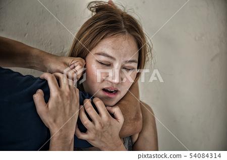 man use arm to strangle woman neck 54084314
