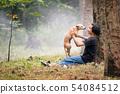 Little Asian girl sitting alone on green field 54084512