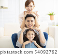 Happy parents and child having fun together 54092792