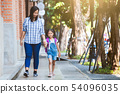 pupil girl hold her mother hand and go to school 54096035