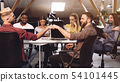 Fist bump. Colleagues celebrating successful teamwork in office 54101445