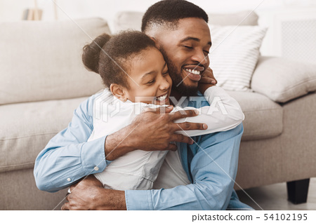 Cute Daughter Hugging Father With Love And Tenderness 54102195