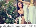 Hanging up the washing. Sexy italian Woman Hanging 54102810