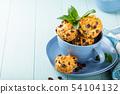 Fresh homemade delicious raisins muffins 54104132