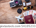 Travel concept on wooden table 54105233