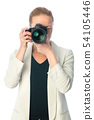 Beautiful young photographer with camera in professional studio 54105446