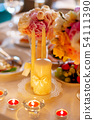 Table set for wedding banquet, candles, flowers 54111390