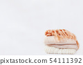 Pile of beige woolen clothes on white background 54111392