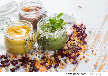 Selection of colorful hummus in jars 54115707