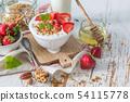 Breakfast - yogurt with granola and straberries 54115778