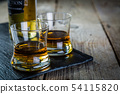 Whiskey with ice in glasses 54115820