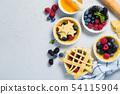 Making berry pie 54115904
