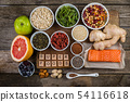 Selection of superfoods on rustic background 54116618