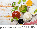 Selection of different sauces in bowls 54116856