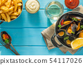 Mussels served with french fries and wine 54117026
