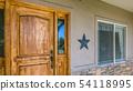 Rustic wooden front door with glass panes of home 54118995