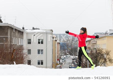 Woman exercising during winter 54126091