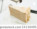 Mille crepe and knife and fork on the table. 54130495