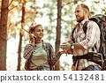 Happy joyful man hiking with his girlfriend 54132481
