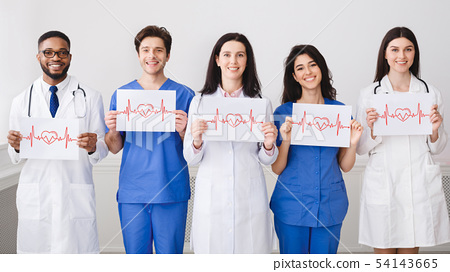 Practitioners Holding Papers With Cadiograms Of Heartbeat 54143665