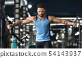 Handsome bodybuilder working out pushing up exercise in gym 54143937