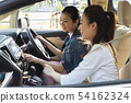 Woman touching car navigation system 54162324