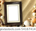 Picture frame on shells and sand background 54167414