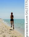girl running seaside 54177775