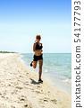 girl running seaside 54177793