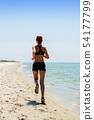 girl running seaside 54177799
