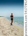 girl running seaside 54177852