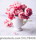 Bouquet of Spring tulips in vase on shabby chic background 54178406