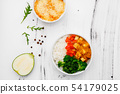 Rice with vegetables in a plate on a white background. Top view. Free space for your text 54179025