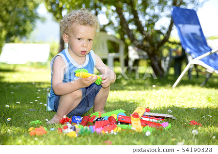 Baby playing on the lawn 54190328