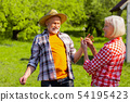 Pensioners feeling happy after blowing at dandelion 54195423