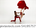 Young graceful couple of ballet dancers dancing on white studio background 54195757