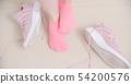 woman has athletes foot 54200576