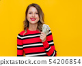 Young woman in red striped sweater with cash  54206854