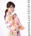 Young woman wearing a yukata 54218130