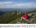 Woman contemplates mountains landscape 54222572