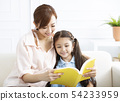 happy mother studying with  little girl  at home 54233959