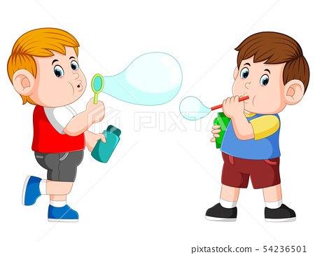 the boy are playing with the bubble soap and blow  54236501