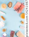 Frame of Scrub peeling brush body scrubber massager loofah bar of soap on blue 54241987