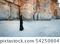 Muslim woman walking on the beach 54250604